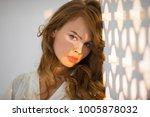 portrait of tender girl in warm ... | Shutterstock . vector #1005878032