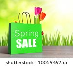 green shopping bag with spring... | Shutterstock . vector #1005946255
