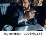 business man with a beard in... | Shutterstock . vector #1005951655