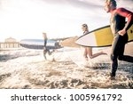 group of friends going to surf... | Shutterstock . vector #1005961792