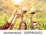 friends hands toasting red wine ... | Shutterstock . vector #1005962632