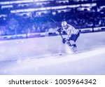 ice hockey player in action... | Shutterstock . vector #1005964342