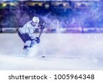 ice hockey player in action... | Shutterstock . vector #1005964348