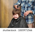 a little boy is trimmed in the... | Shutterstock . vector #1005971566
