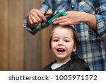 a little boy is trimmed in the... | Shutterstock . vector #1005971572