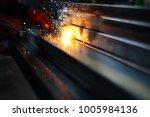 hand hold welding steel.... | Shutterstock . vector #1005984136