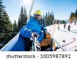 skier wearing skis  helmet and... | Shutterstock . vector #1005987892