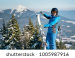 shot of a smiling woman skier... | Shutterstock . vector #1005987916