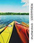 kayaking on the lake concept... | Shutterstock . vector #1005995836
