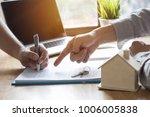 hand of bank employeer point...   Shutterstock . vector #1006005838