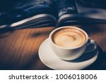 cup of coffee in cafe in dark... | Shutterstock . vector #1006018006