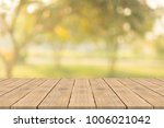 empty wood table top on nature... | Shutterstock . vector #1006021042