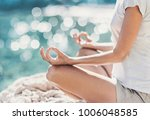 young woman practicing yoga... | Shutterstock . vector #1006048585