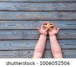 starfish in the hands of a... | Shutterstock . vector #1006052506