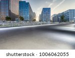 empty road with modern business ... | Shutterstock . vector #1006062055