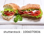 two sandwiches with ham and... | Shutterstock . vector #1006070836