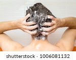 young manis washing his hair ... | Shutterstock . vector #1006081132
