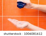 man is pouring shampoo on his... | Shutterstock . vector #1006081612