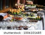 holiday buffet table served by... | Shutterstock . vector #1006101685