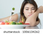 unhappy asian women is on... | Shutterstock . vector #1006134262