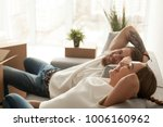 happy couple relaxing on sofa... | Shutterstock . vector #1006160962
