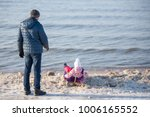 little girl child is towing... | Shutterstock . vector #1006165552