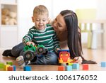 mother and her child son plays... | Shutterstock . vector #1006176052