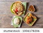 sticky rice with papaya salad | Shutterstock . vector #1006178206