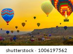sunset hot air balloons landing ... | Shutterstock . vector #1006197562