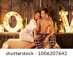 the happy couple in a photo... | Shutterstock . vector #1006207642