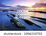 Small photo of Motivational and inspirational quote - Decide, commit, succeed. Blurry background.
