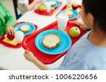 schoolgirl carrying red plastic ... | Shutterstock . vector #1006220656