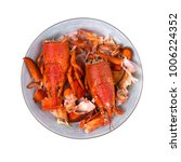 plate of leftover lobsters on a ... | Shutterstock . vector #1006224352