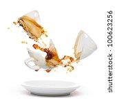 Broken coffee mug with splash of coffee. Isolated on white - stock photo