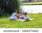 family walks on nature | Shutterstock . vector #1006574662