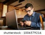 handsome businessman distracted ... | Shutterstock . vector #1006579216