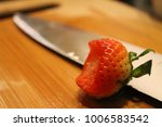 Small photo of A strawberry with abite taken out