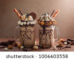 chocolate  milkshake with ice... | Shutterstock . vector #1006603558