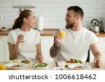 smiling couple enjoying dinner... | Shutterstock . vector #1006618462