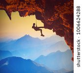 climber on a rocky cliff in a... | Shutterstock . vector #1006624288