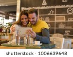 couple enjoying in a coffee... | Shutterstock . vector #1006639648