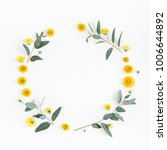Stock photo flowers composition wreath made of various yellow flowers and eucalyptus branches on white 1006644892