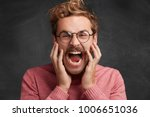 fierce mad young male shouts... | Shutterstock . vector #1006651036