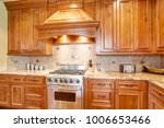gourmet kitchen boasts a curved ... | Shutterstock . vector #1006653466