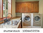 huge laundry room with white... | Shutterstock . vector #1006653556