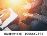 psychologist listening to her... | Shutterstock . vector #1006662598