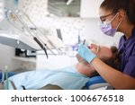 female dentist working with... | Shutterstock . vector #1006676518