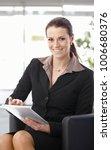 businesswoman sitting in... | Shutterstock . vector #1006680376