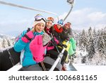 girls with guy in ski lift... | Shutterstock . vector #1006681165