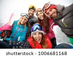 happy group of  young skiers on ... | Shutterstock . vector #1006681168